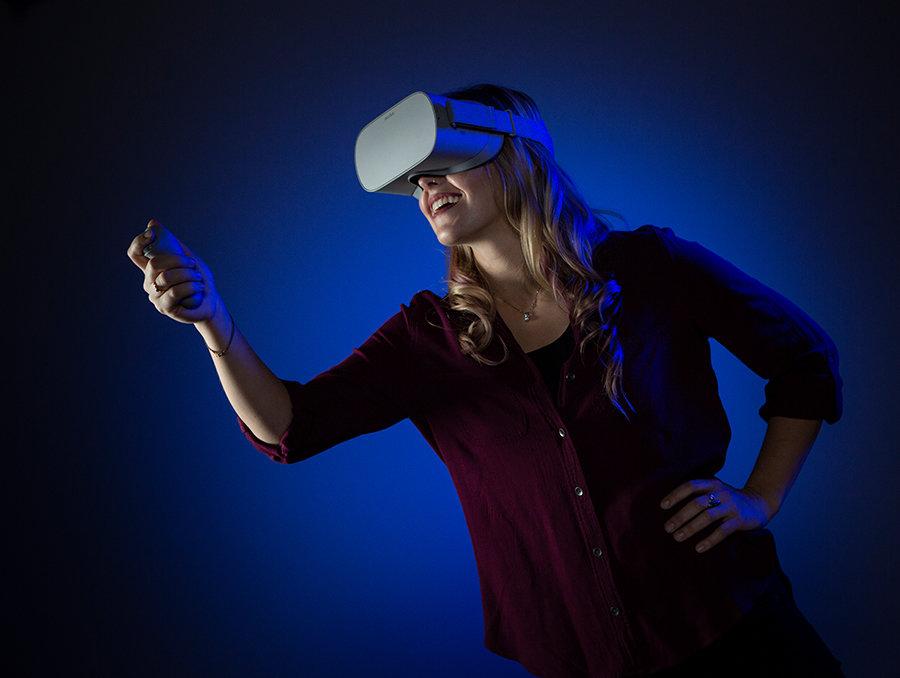 Michelle Rebaleati posing in VR gear