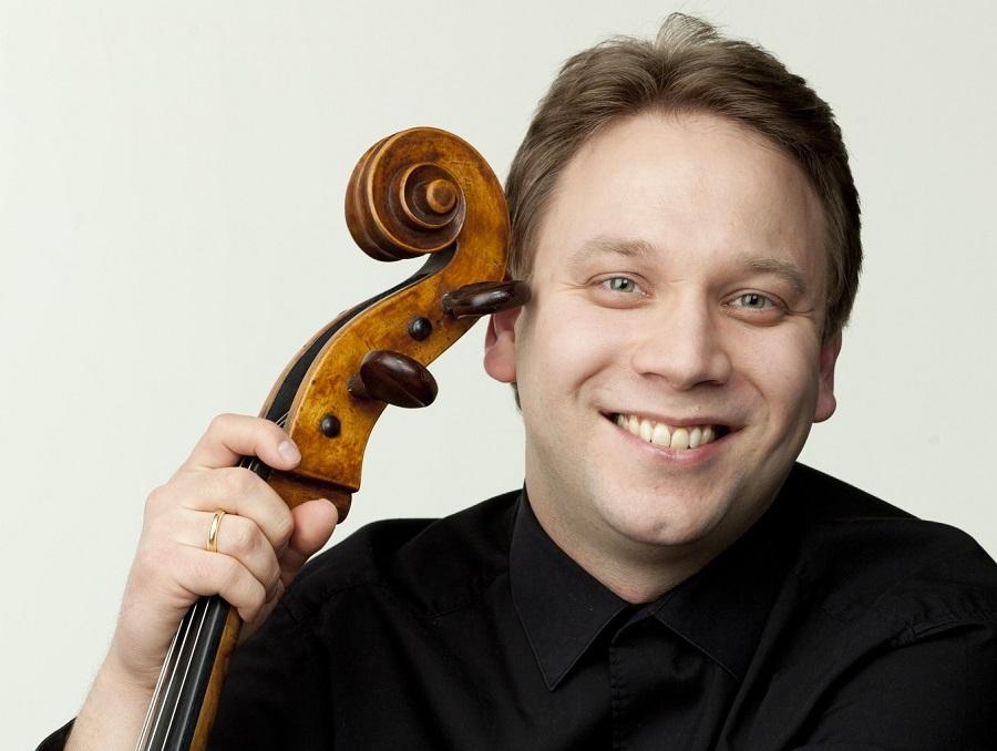 Dmitri Atapine holds his cello
