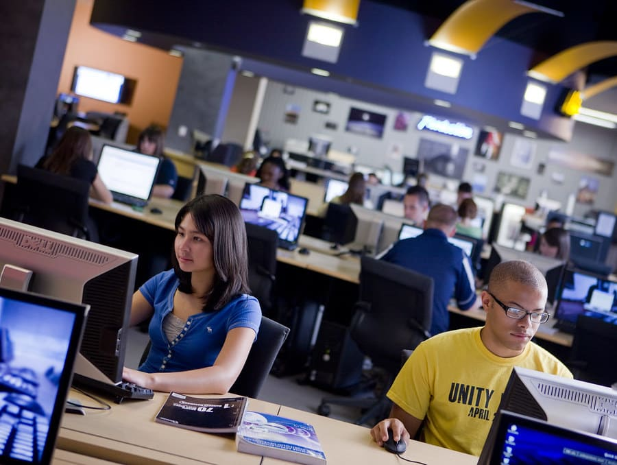 Students working on computers in the @One Computer Lab on campus at the University.