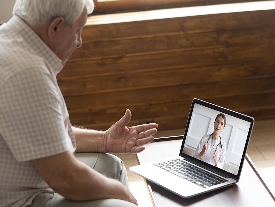 A patient and his health care provider are pictured during a telehealth consultation.