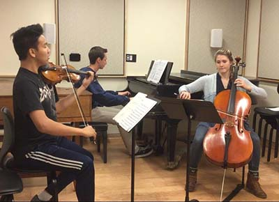 Kara Bainter in her Piano trio rehearsal with  Manny Orozco (violin) and Raymond Passe (piano).