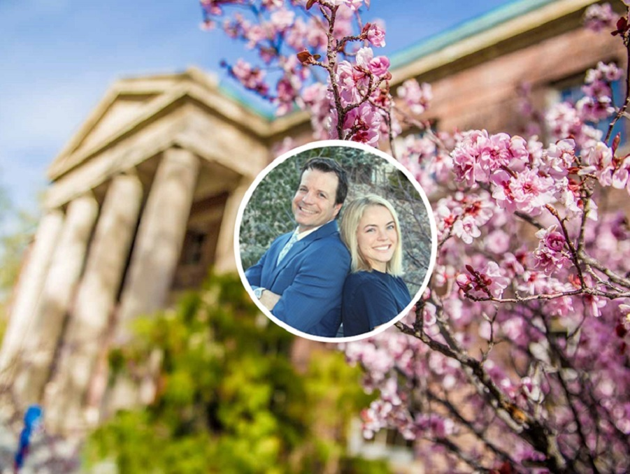 Spring blooms in front of the Mackay Building with a photo of Steve Maples and his daughter in the middle.