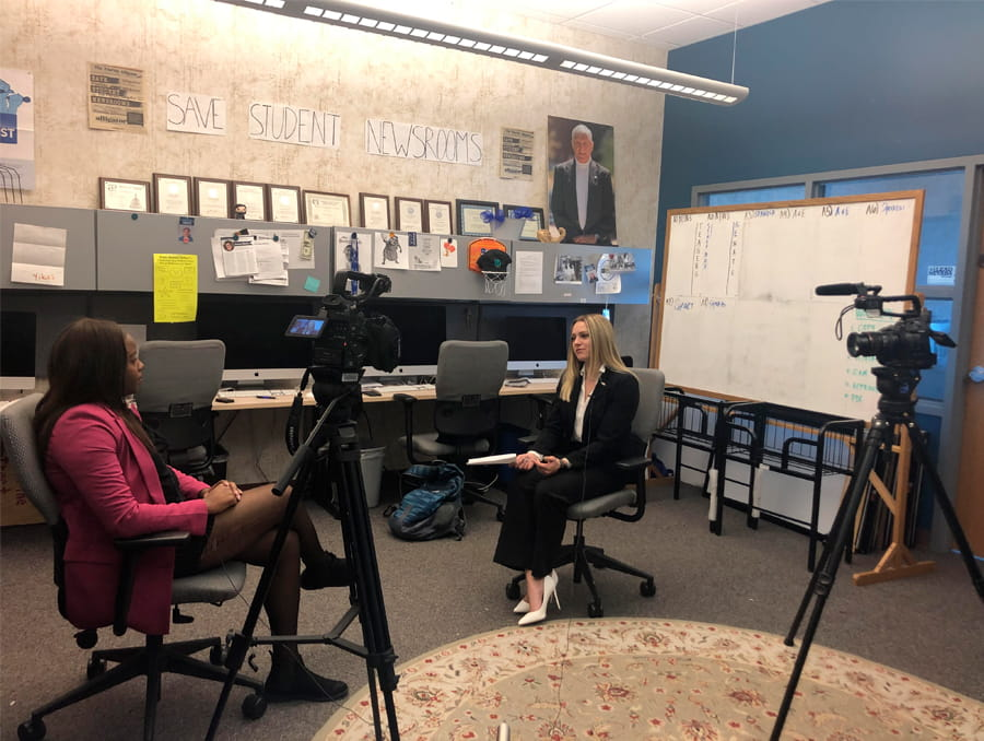Student reporter from the Nevada Sagebrush interviews ASUN President Dominique Hall.