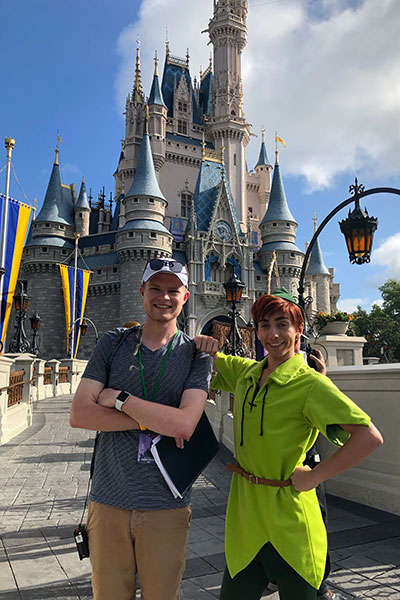 James Rutter poses with a costumed actor at Disney World.