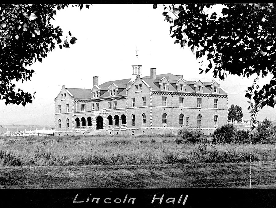 """Black and white photograph of a building with written text below that reads """"Lincoln Hall"""""""