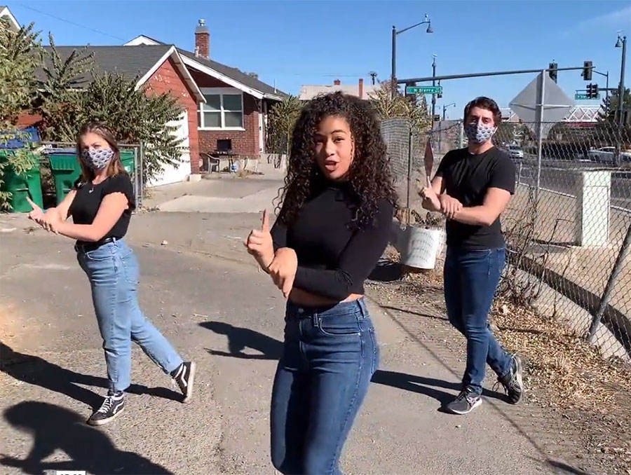 """Jasmine Johnson, Kennedy Gaskins and Cam Mauer film the """"Bruised and Brave"""" performance outside on street"""