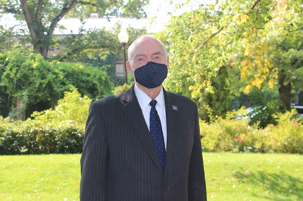 President Marc Johnson wearing a mask
