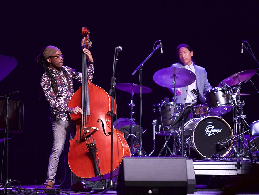 Two Reno Jazz Festival musicians perform on stage.