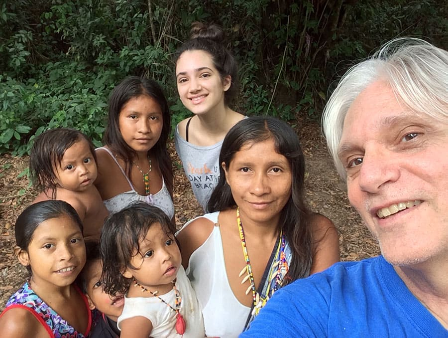 Professor Louis Forline poses with daughter and Amazonian community members in Brazil