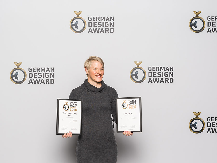 Monica Maccaux holding two design awards at the German Design Awards 2020 event