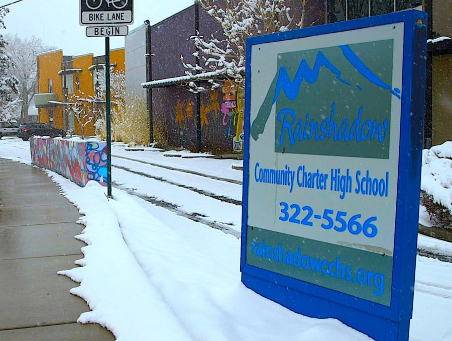Rainshadow Community Charter High School school sign outdoors in winter.