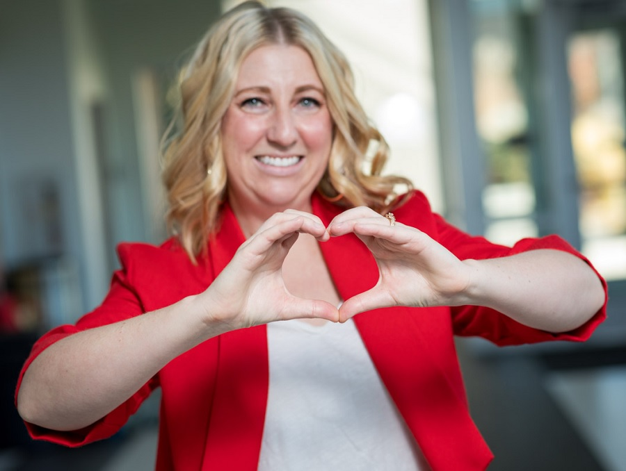 Dr. Lorrel Toft making a heart with her hands