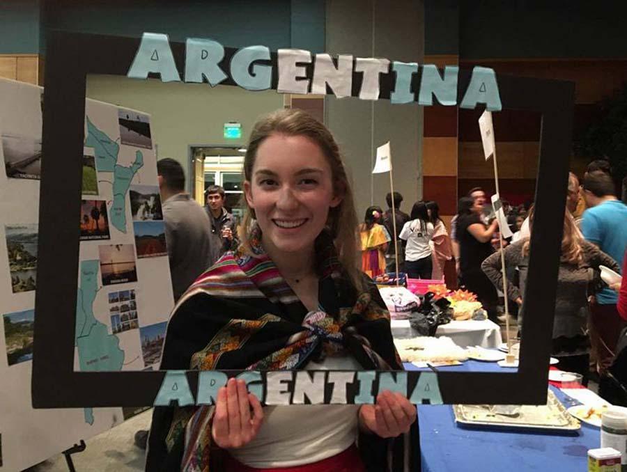 Student holding up Argentina cardboard frame