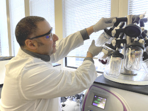 Researcher Yftah Tal-Gan operating the lab's peptide freeze-drying machine.