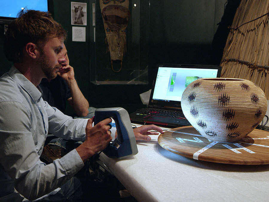 Luka Starmer uses a 3D scanner to capture the Dat So La Lee basket which can be viewed at the Nevada Historical Society