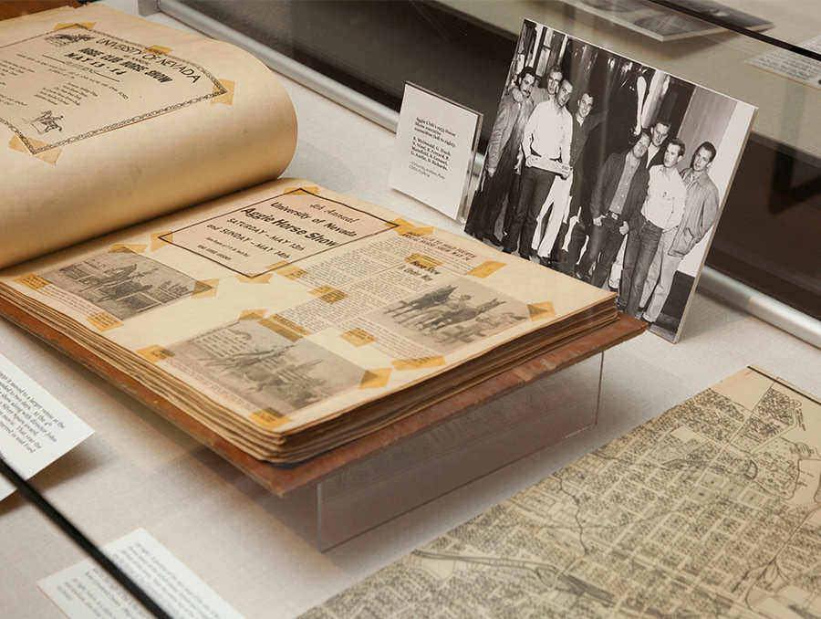Special Collections book open in front of a photograph