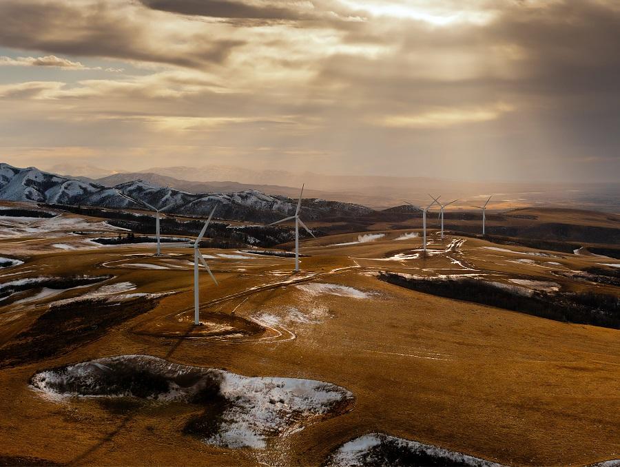 Wind turbines on a snowy desert landscape