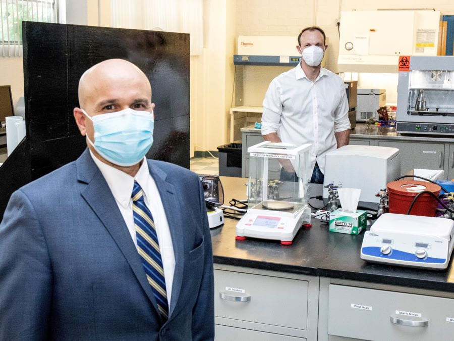 Carlos Cardillo of the Nevada Center for Applied Research and Jonathan Hull of Bioelectronica stand in the biosciences laboratory managed by NCAR.