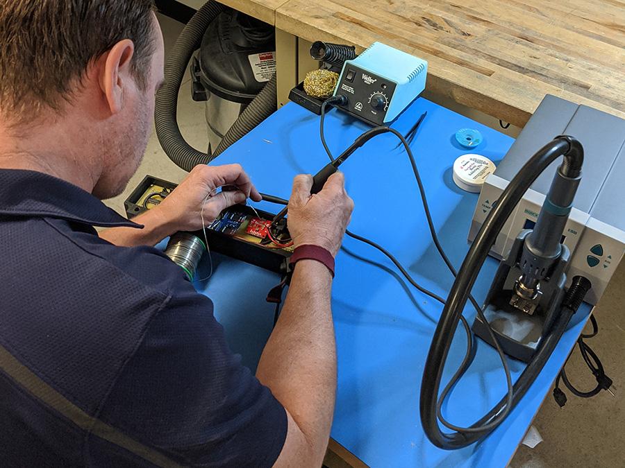 tech working on building sensor