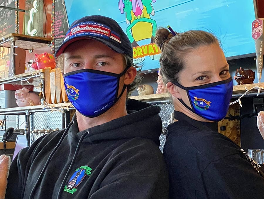 Local small business owners wearing Nevada branded face masks.