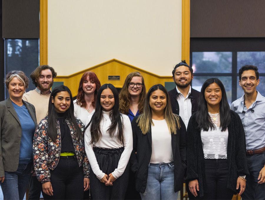 The PRSSA board members pose in the Linn Reading Room of the Reynolds School of Journalism