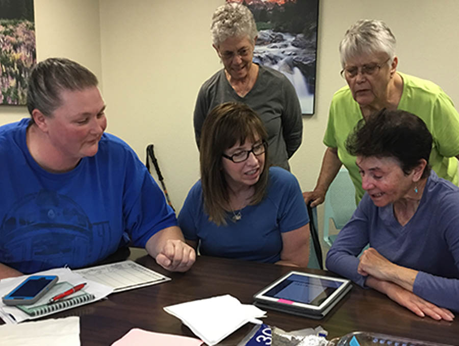 In a Not Alone Aphasia Communication Group, aphasia participants practice communication using multiple platforms.
