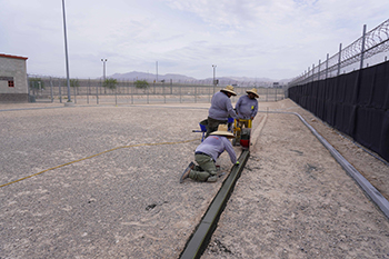 Workers installing track at correctional facility