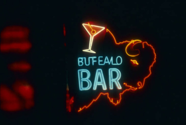 "Neon on sign of the a buffalo that reads ""Buffalo Bar"""