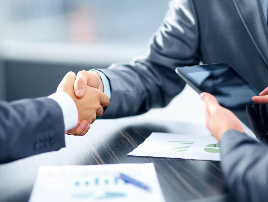 two people in business suits shaking hands