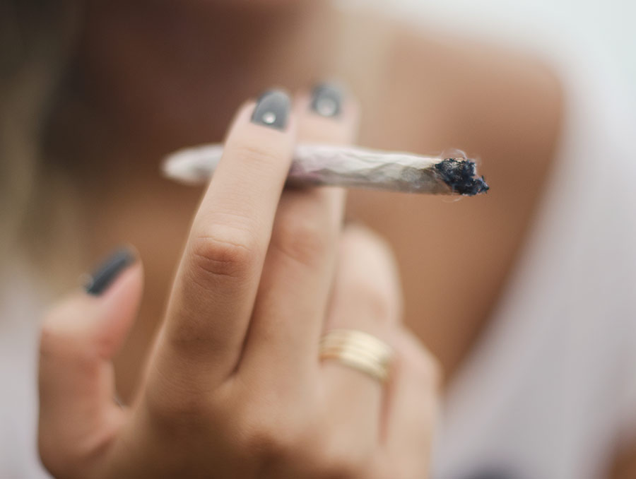 Person holding a cannabis blunt