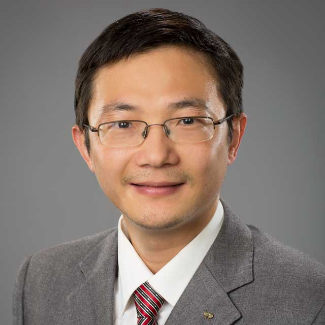 A headshot of Guoping Xiong.