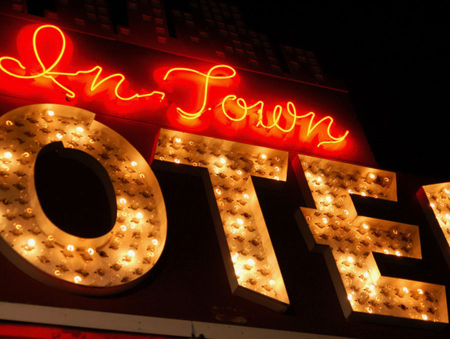 "Neon sign that reads ""In Town Motel"""