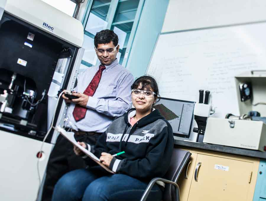 A photo of Pradeep Menezes in a lab with one of his students.