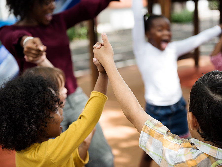 Group of diverse children holding hands