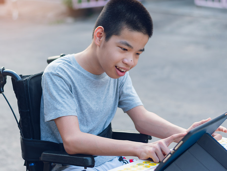 Student with special needs on a tablet computer