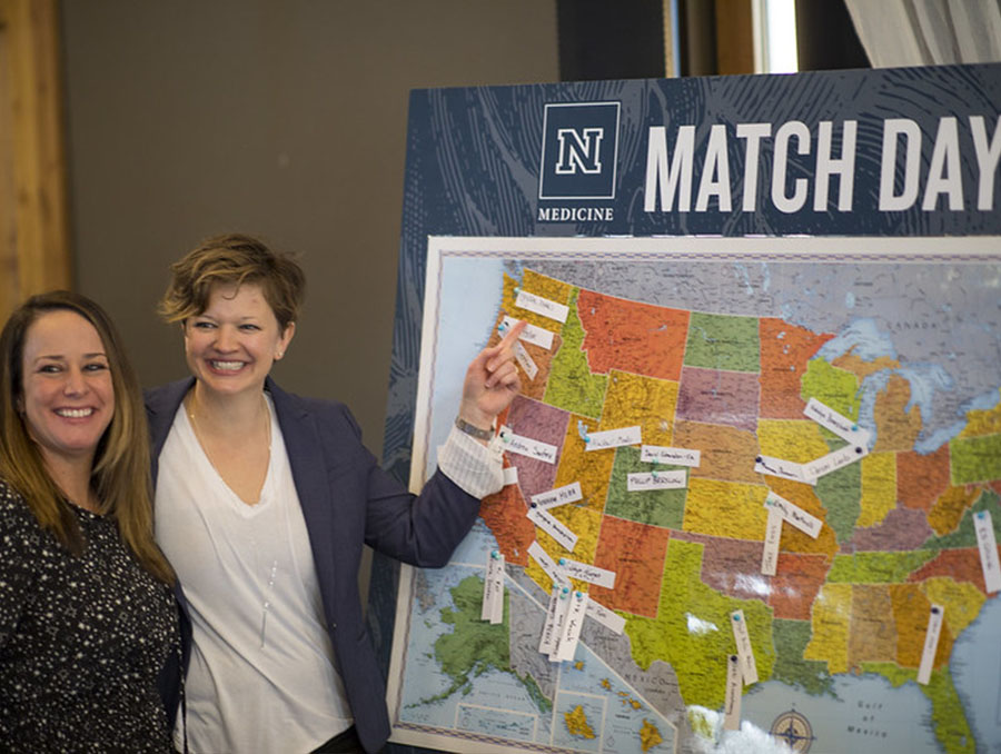 A UNR Med medical student places a pin on the Match Day map.