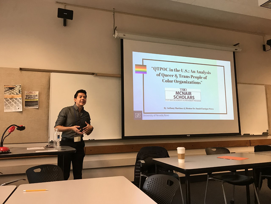 McNair Program Scholar Anthony Martinez gives a research presentation in a classroom at the University of Nevada, Reno