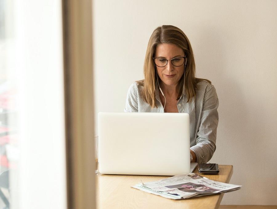 Woman using laptop while sitting