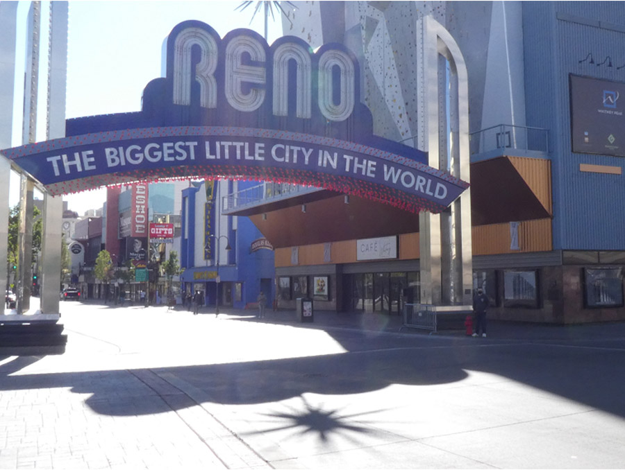 The author, standing at the base of the Reno Arch, surrounded by empty streets during the COVID-19 Pandemic