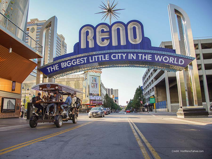 The Downtown Reno arch and Reno Brew Bike. Credit VisitRenoTahoe.com