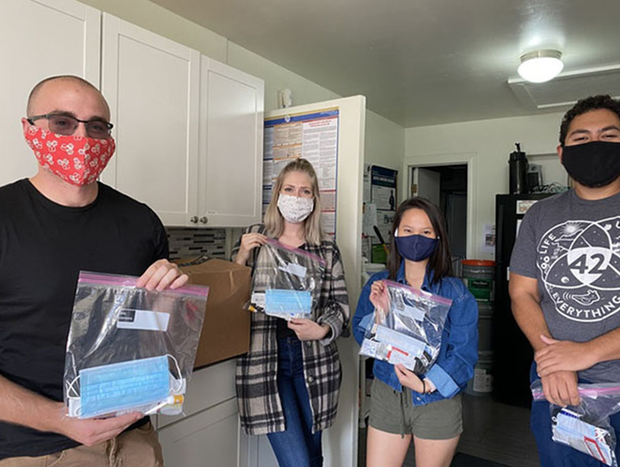 A photo of UNR Med's Health and Hygiene Student Interest Group leaders posing with kits of health and hygiene products for underserved populations.