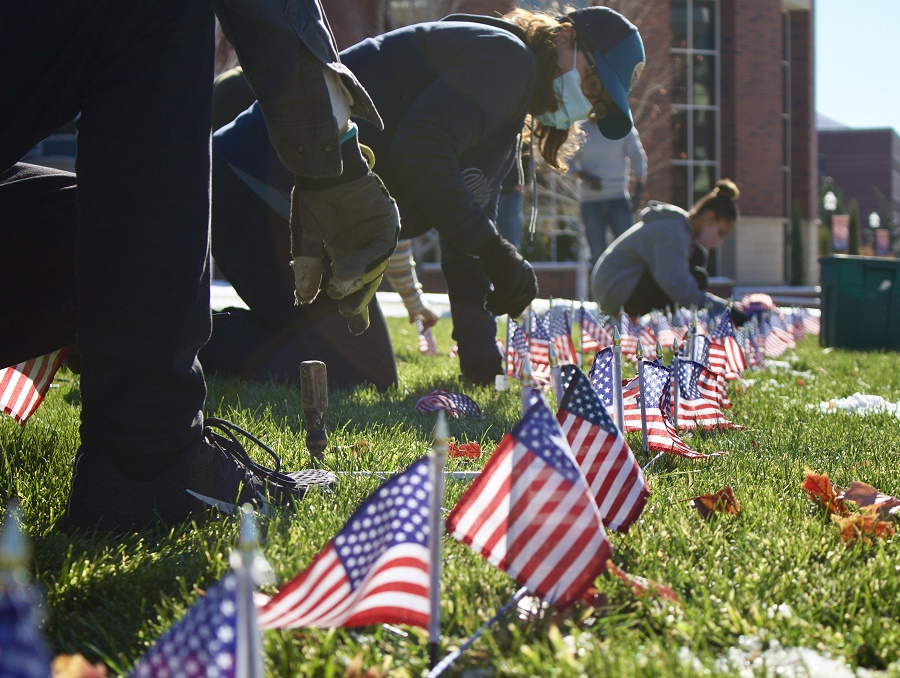 Students placing flags into the JCSU lawn