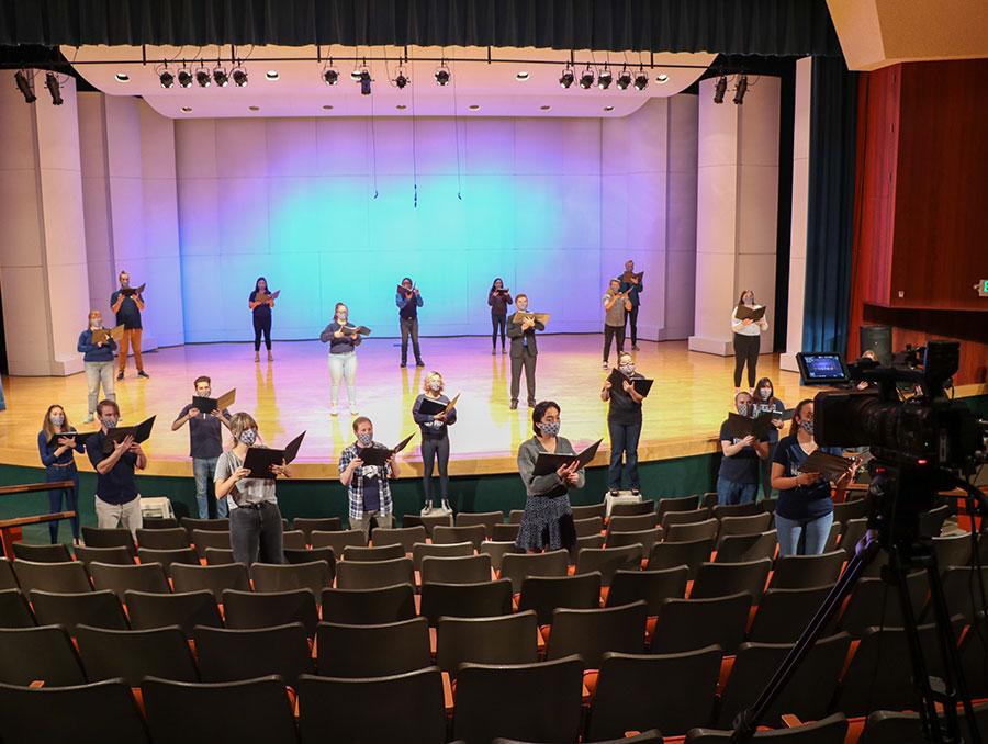 Choir sings in masks on stage