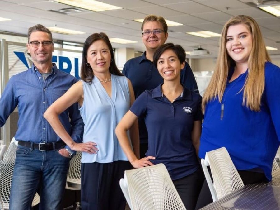 Photo of Jim Sacherman, the center's first director, current Director Grace Chou, Makerspace Specialist Daniel Smith, Assistant Director Crystal Harvey and Office Coordinator Ania Cavillo-Mason.