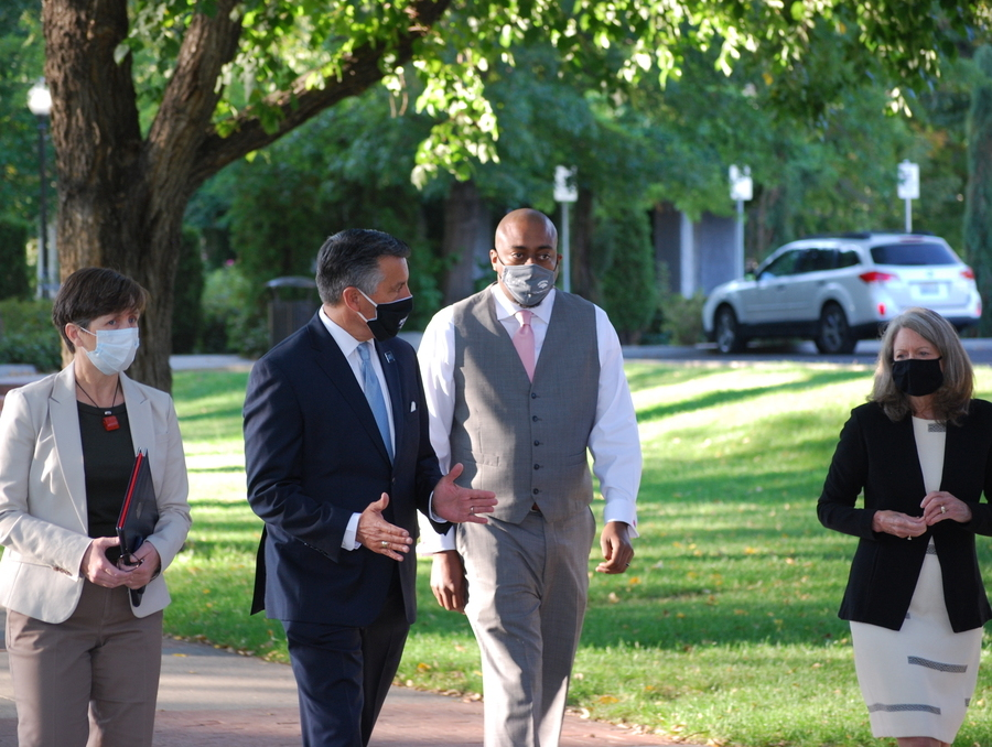 President Sandoval walks the University Quad with senior staff members