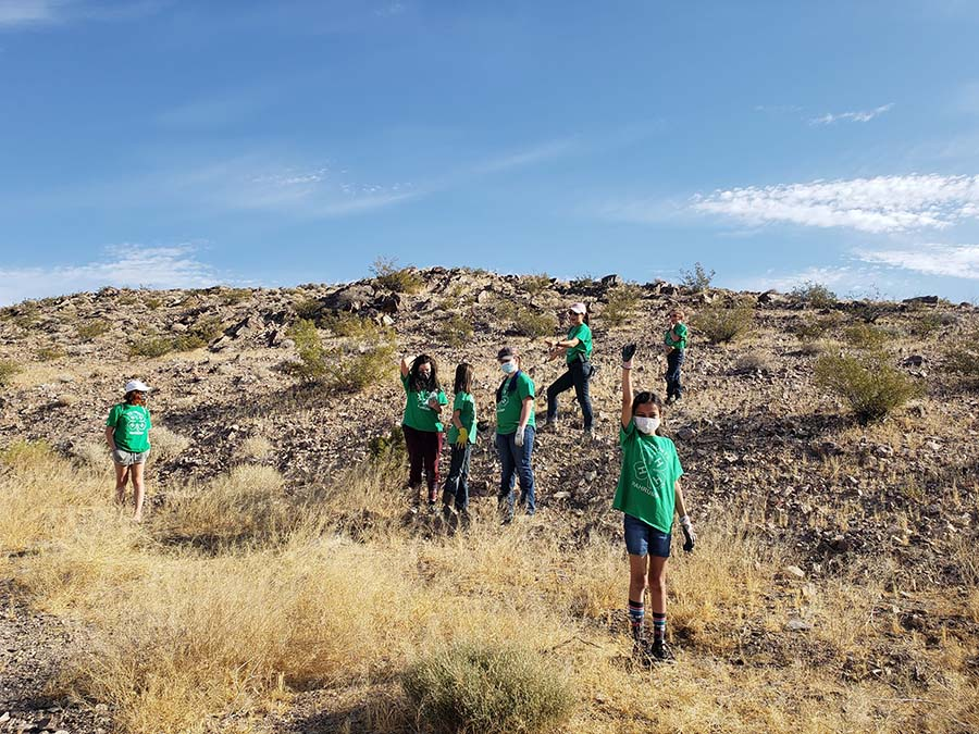 4-H youth clearing trash out of the desert