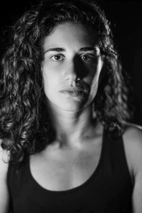 Luiza Vieira black and white headshot.