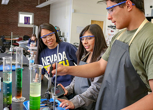 Nevada Teach students working on a science project in the classroom