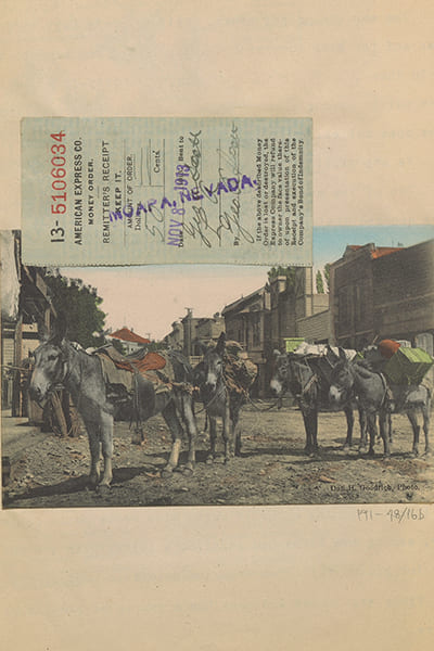Scanned image of a group of saddled donkeys in a town.