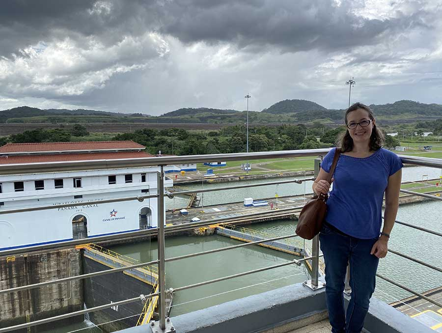 Professor Renata Keller pictured on a dock overlooking the Panama Canal